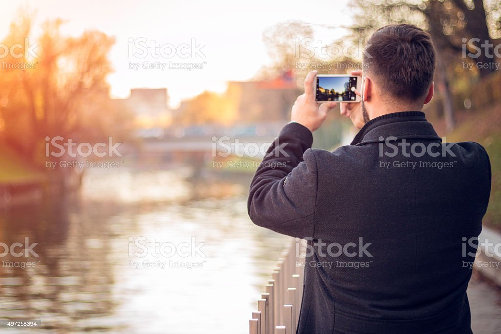 Taking Photo with smartphone stock photo