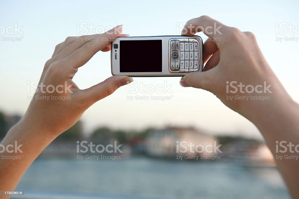 taking photograph with cell phone stock photo