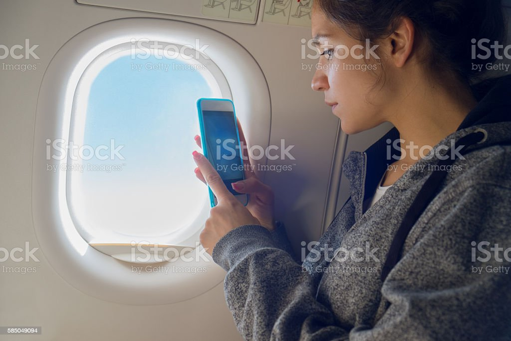 Taking photos from airplane stock photo