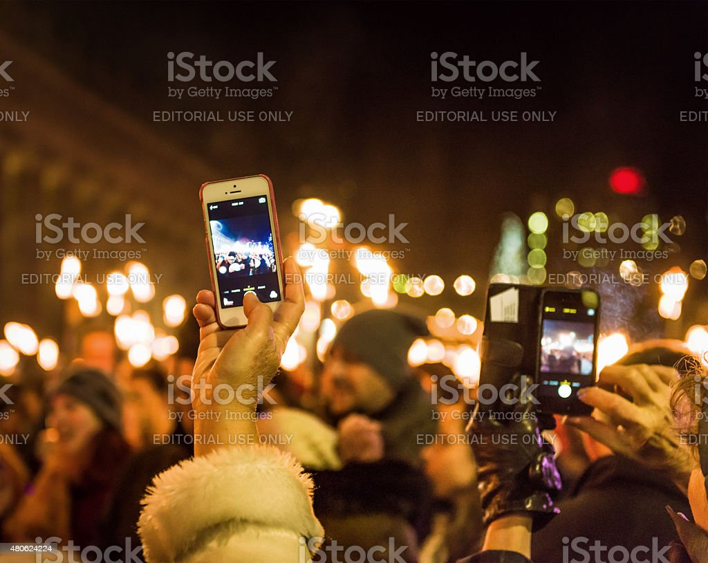 Taking photos of a celebration with smartphones stock photo