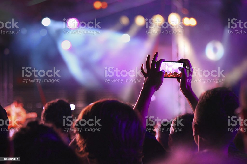 Taking picture at a music concert stock photo
