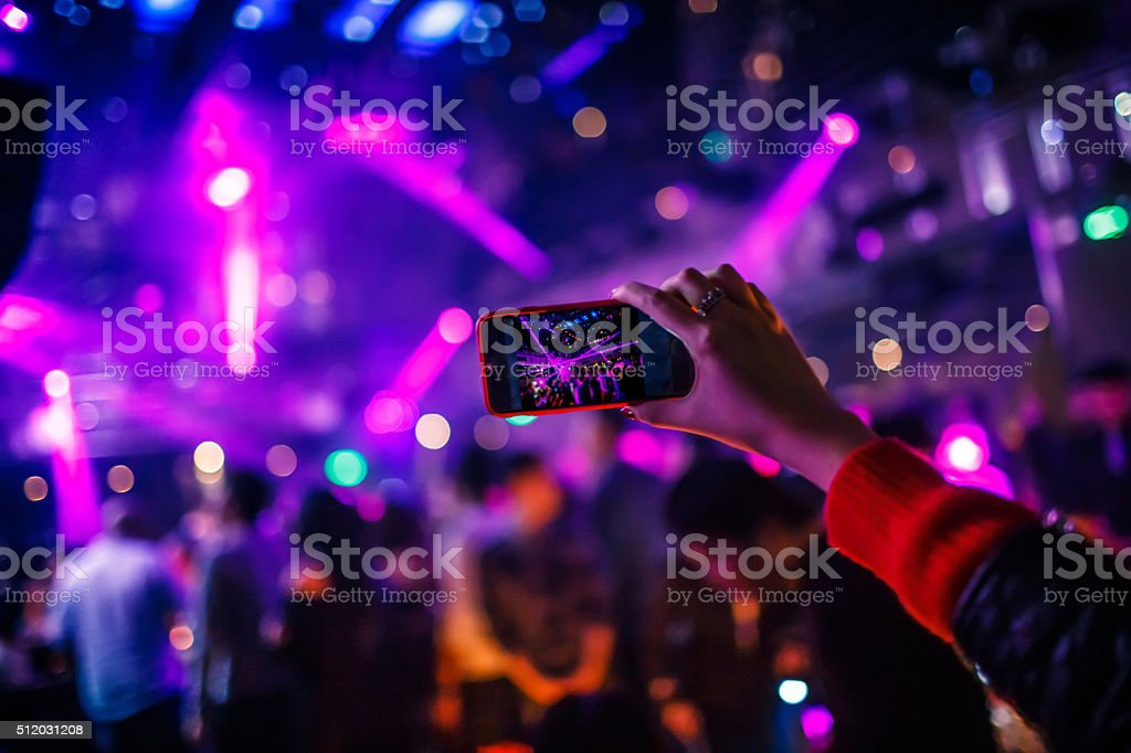 Taking picture at a night club stock photo