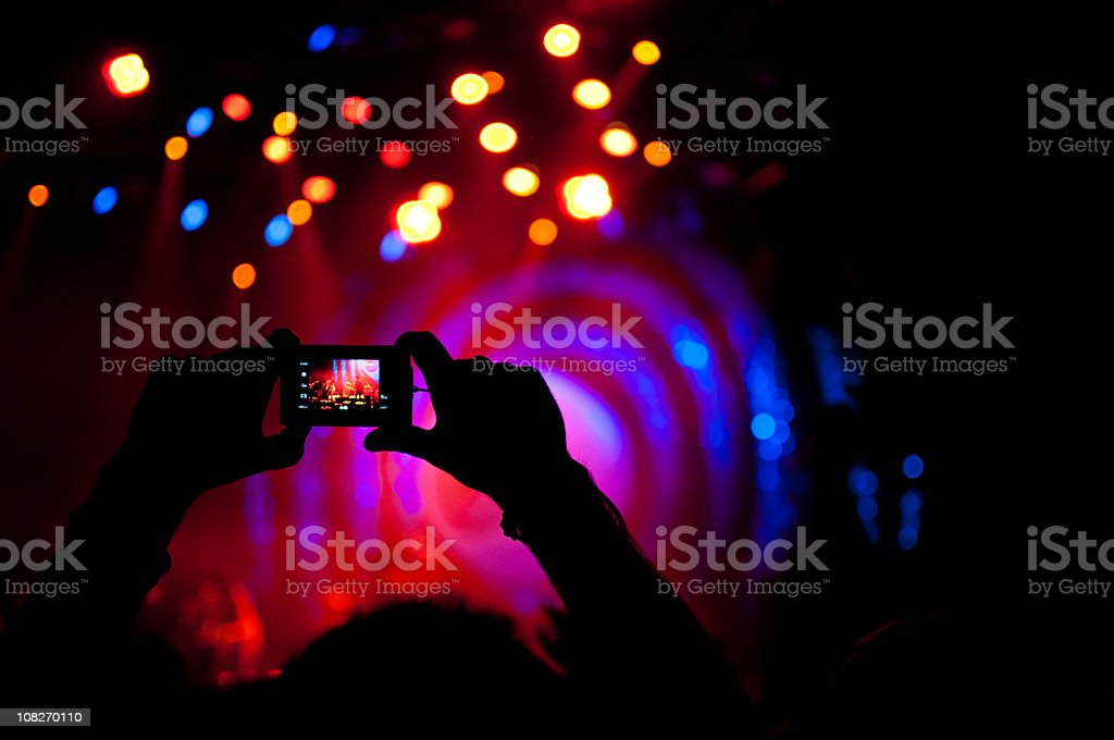 taking picture at live concert royalty-free stock photo