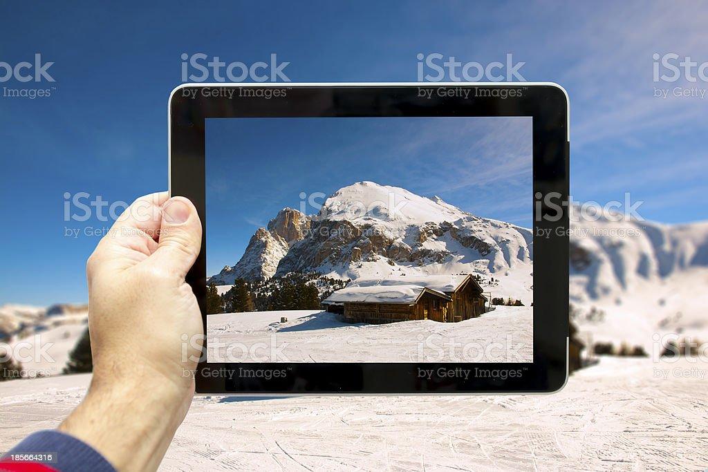 Taking picture at Siusi Alp (Italian Dolomites) stock photo