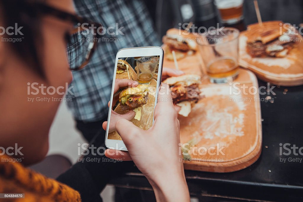 Taking Picture Of Burger stock photo