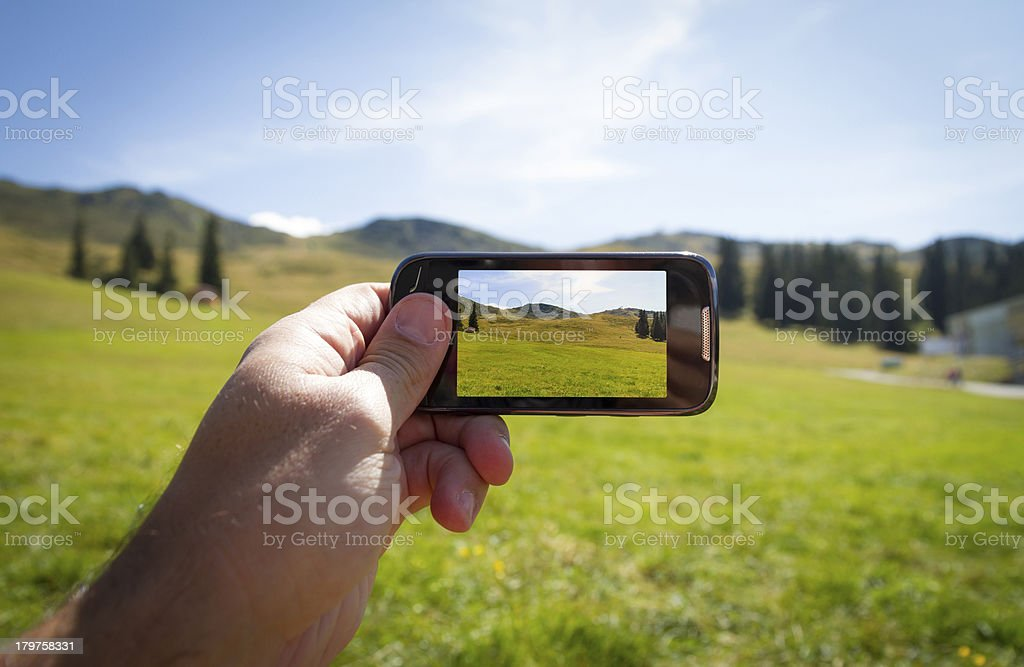 Taking picture of Dolomites in summer time royalty-free stock photo