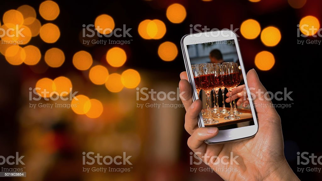 Taking picture of wine glasses during wedding reception stock photo