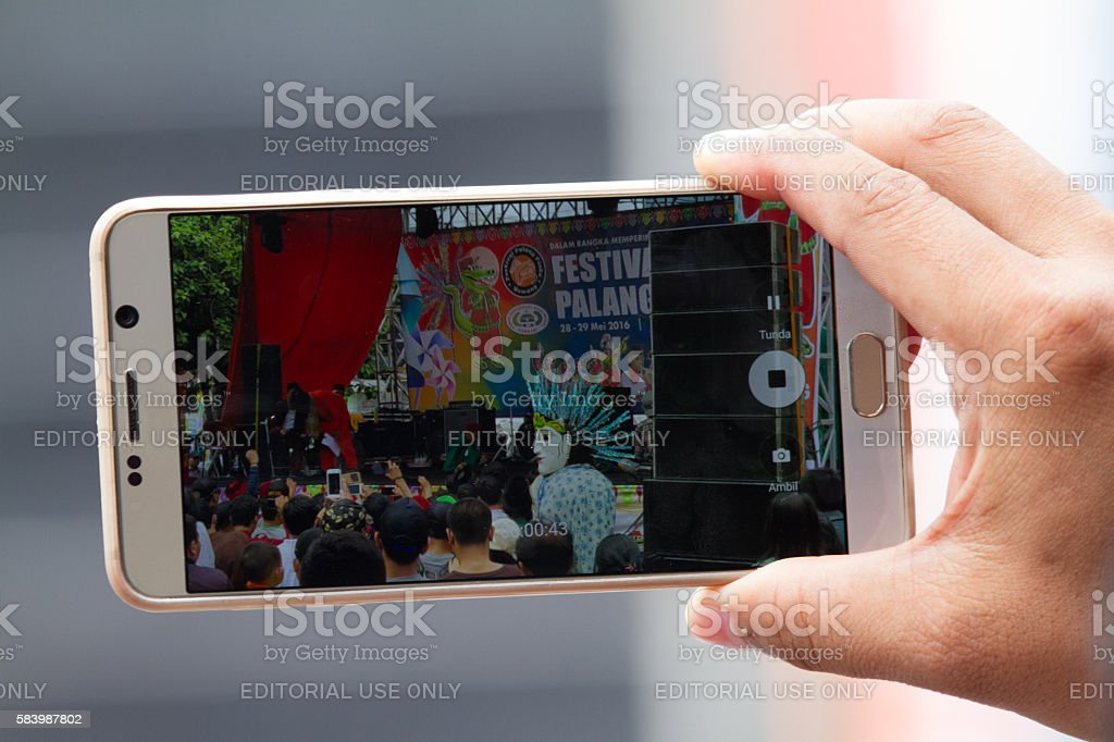 Taking Picture with a Smartphone stock photo