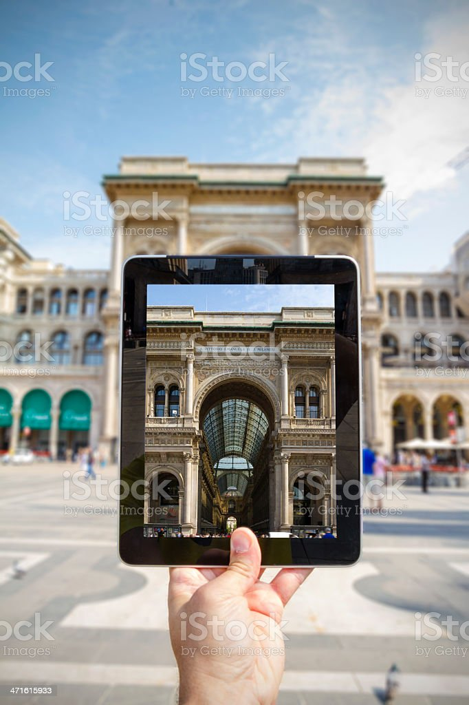 Taking picture with digital tablet in Milan stock photo
