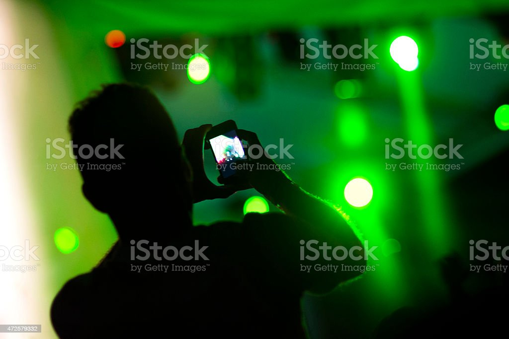Taking pictures at the concert stock photo