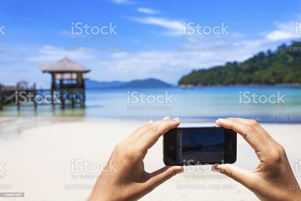 Taking Pictures at the Tropics with Smartphone (Iphone) royalty-free stock photo