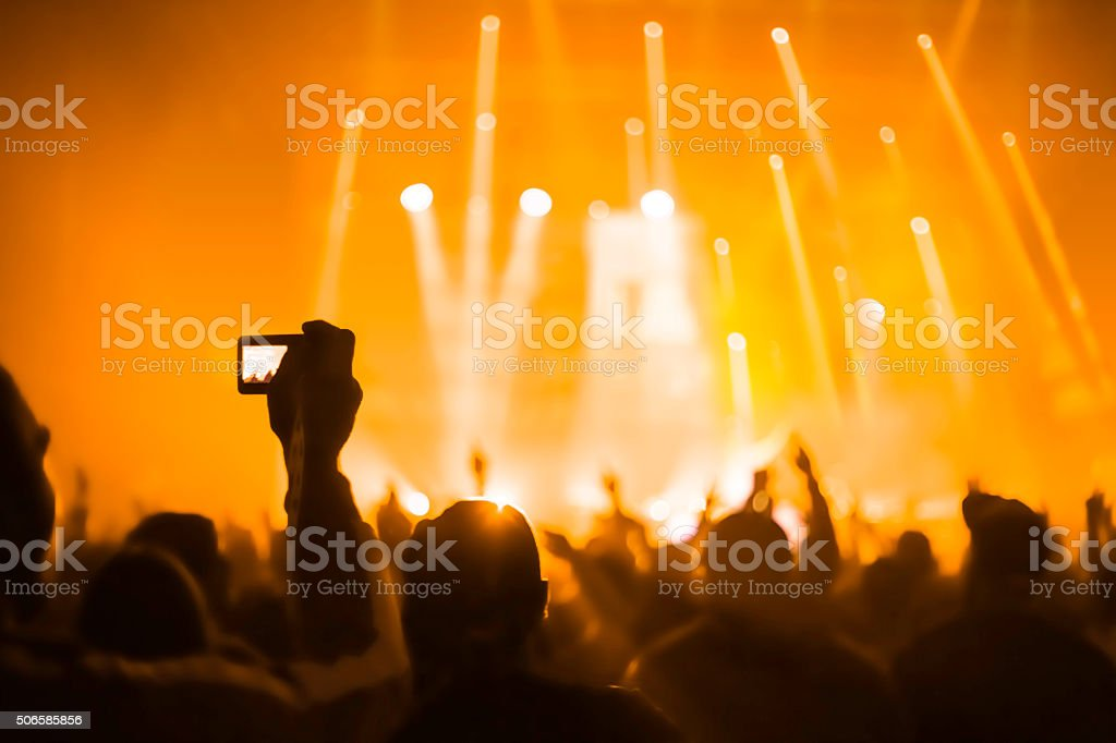 taking pictures  during a music concert stock photo