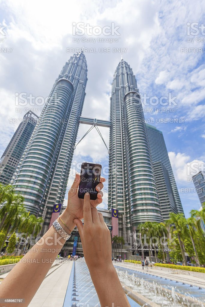 Taking Pictures in Kuala Lumpur with Smartphone (Iphone) stock photo