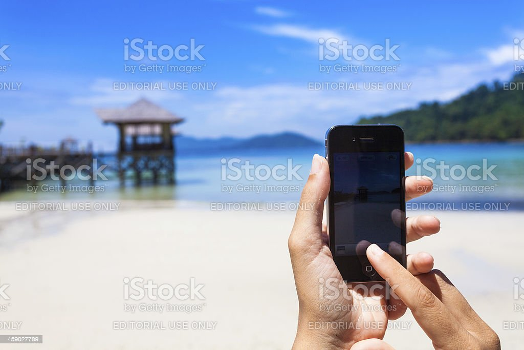 Taking Pictures in Tropical Island with Smartphone (Iphone) stock photo
