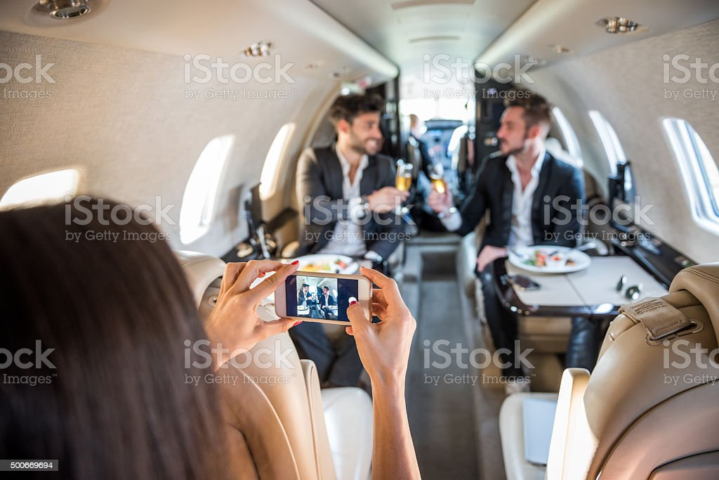 Taking pictures inside private jet airplane stock photo