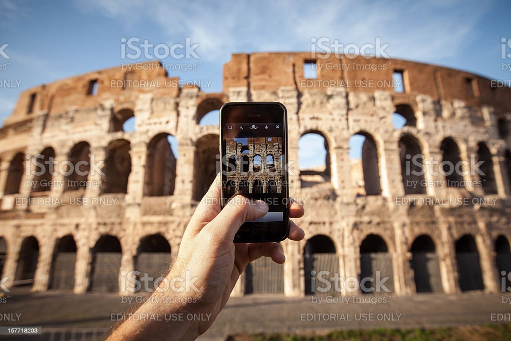 Taking pictures of the Coliseum with Iphone 5 stock photo