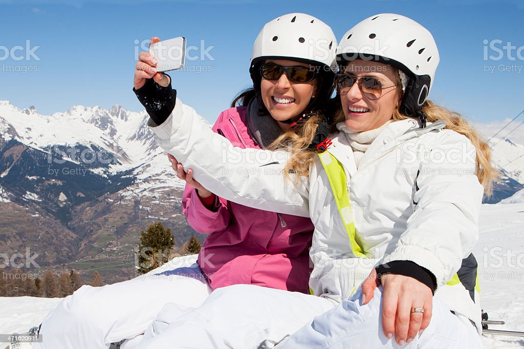 Taking Pictures on the Piste royalty-free stock photo