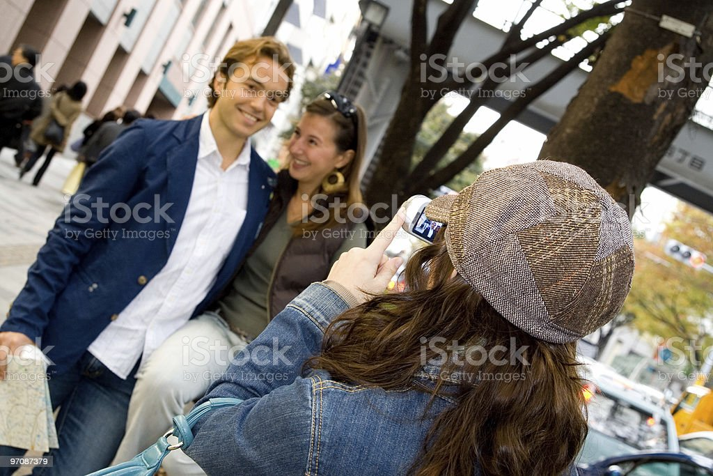 Taking pictures to a young couple royalty-free stock photo