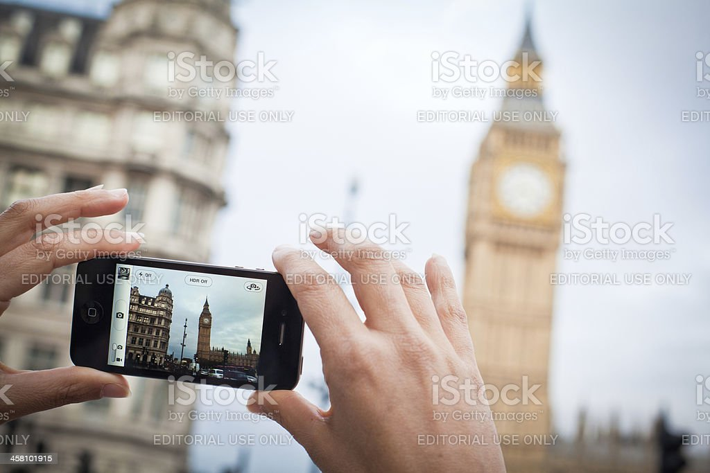 Taking Pictures with Iphone 4 in London stock photo