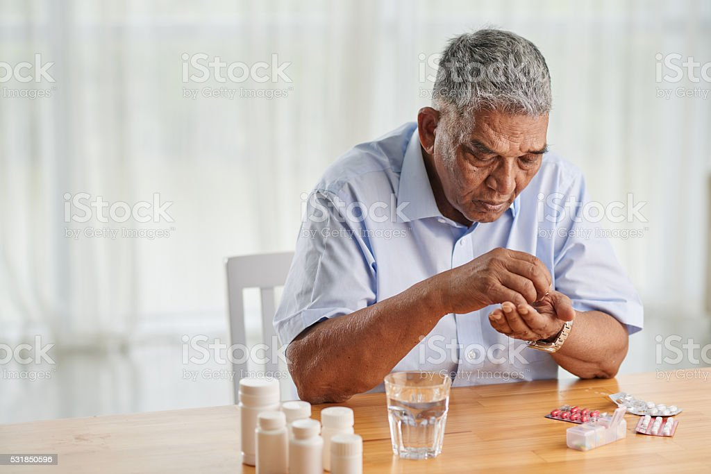 Taking pills stock photo