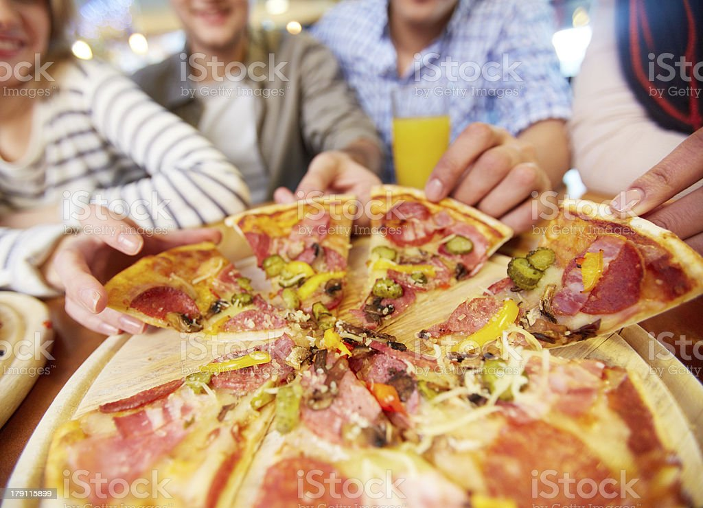 Taking pizza royalty-free stock photo