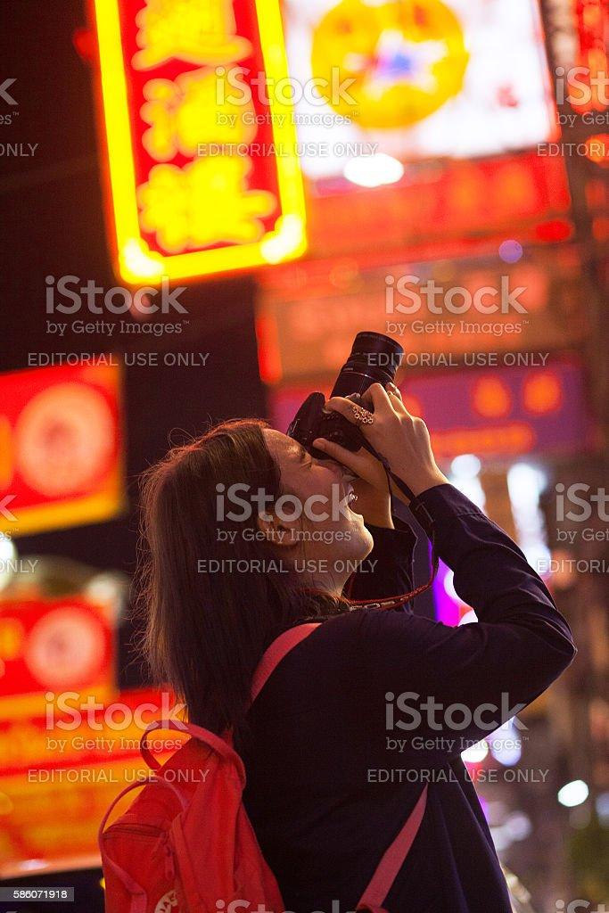 Taking potos in Chinatown at night stock photo