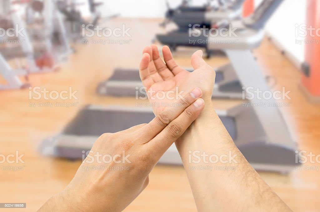 taking pulse at the gym stock photo