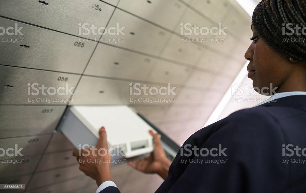 Taking Safety Deposit Box stock photo