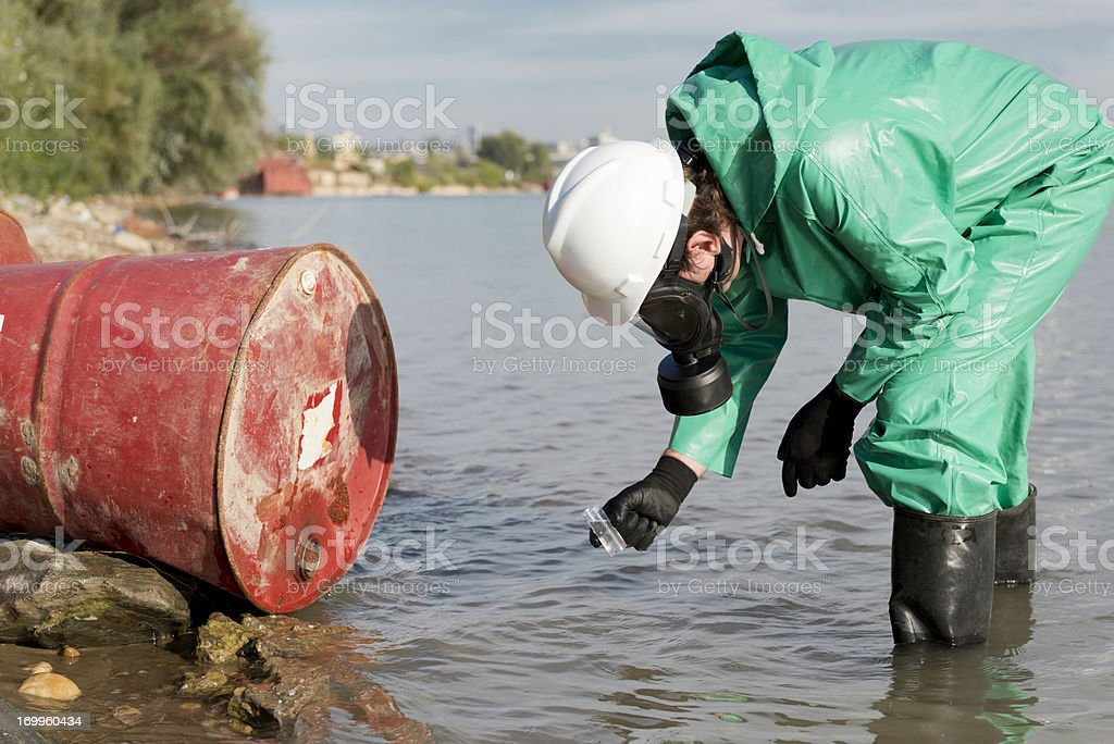 Taking sample of water stock photo