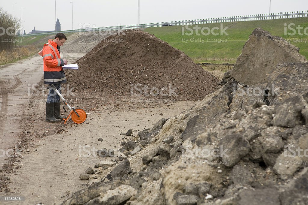 Taking samples of polluted soil stock photo