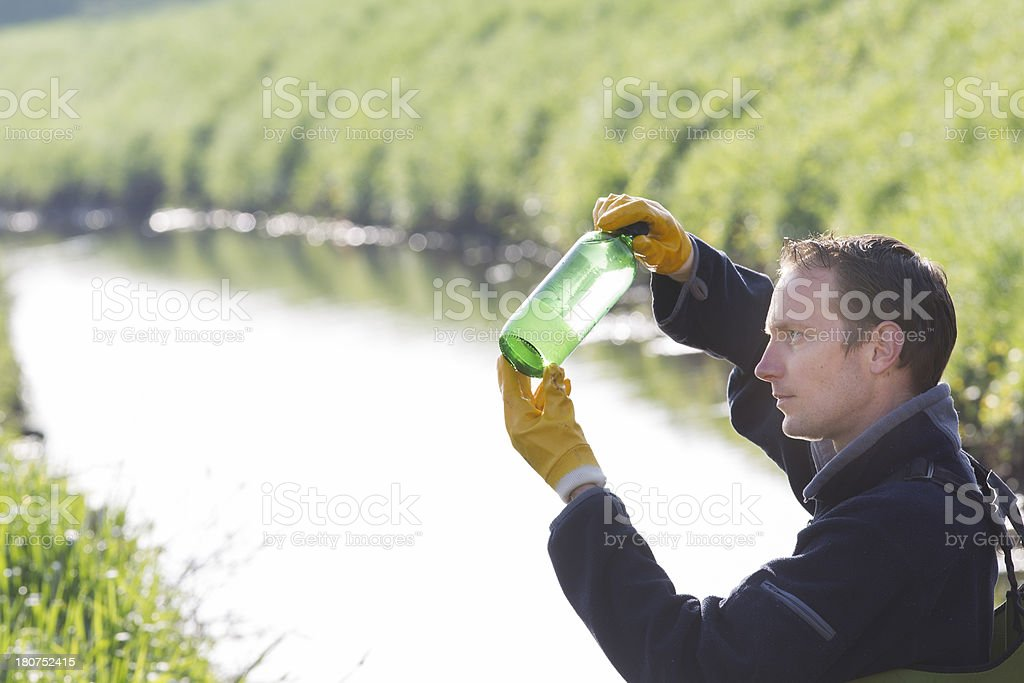 Taking samples of the soil and water, environmental research royalty-free stock photo