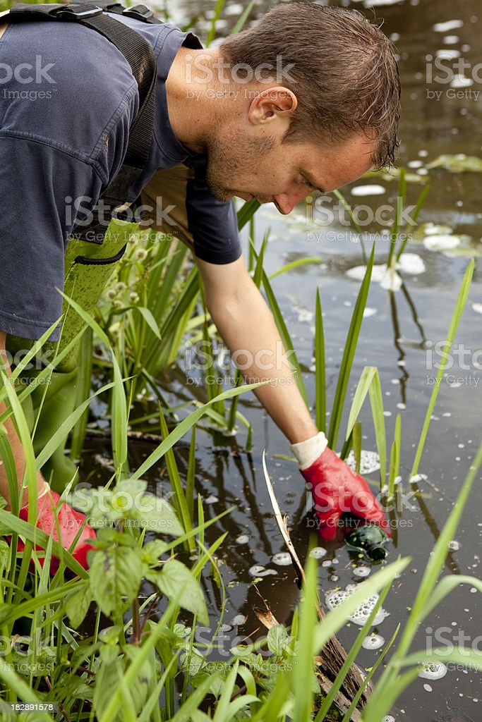 Taking samples of the soil and  water, environmental research. stock photo