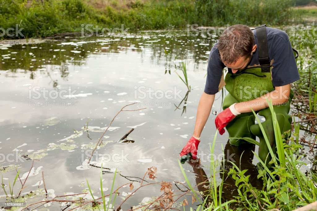Taking samples of the soil and water, environmental research stock photo