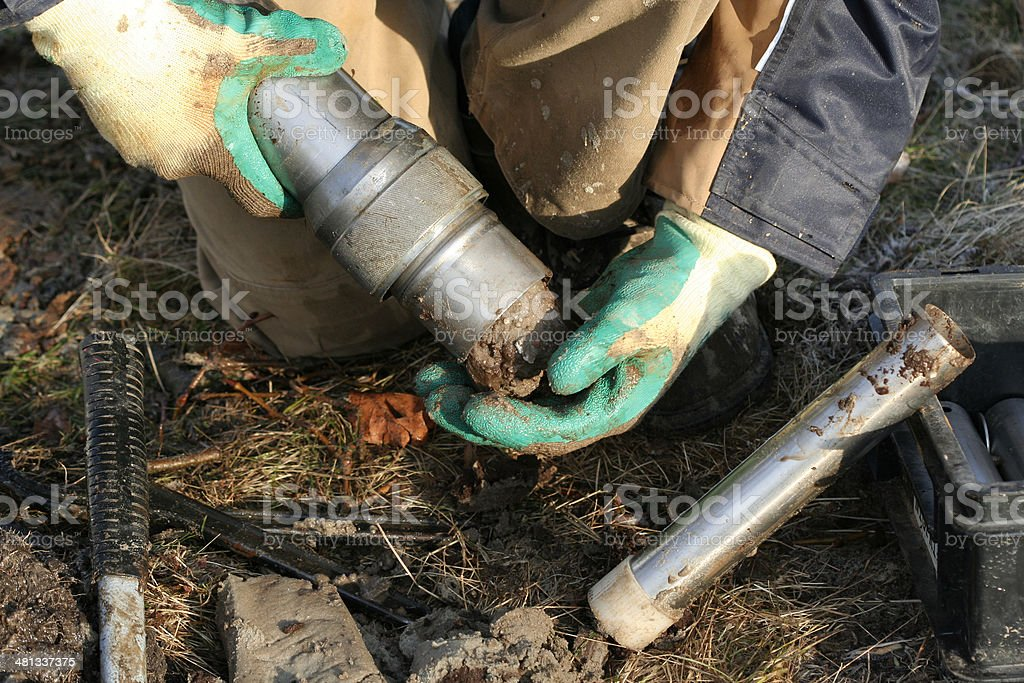 Taking samples of the soil, environmental research. royalty-free stock photo