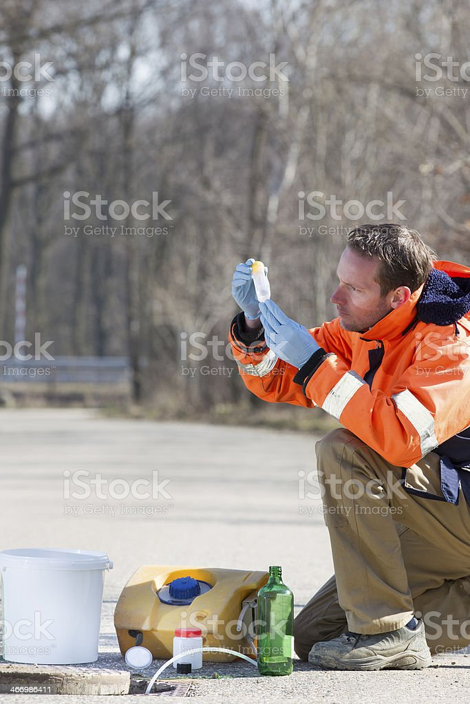 Taking samples of the waste water, environmental research royalty-free stock photo