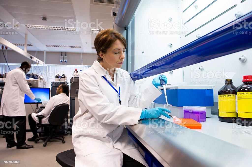 Taking Samples with a Pipette stock photo