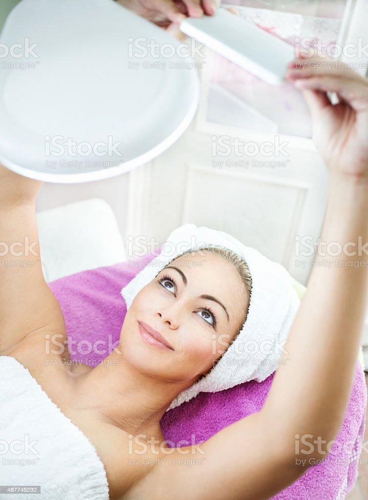 Taking selfie at beauty salon. stock photo