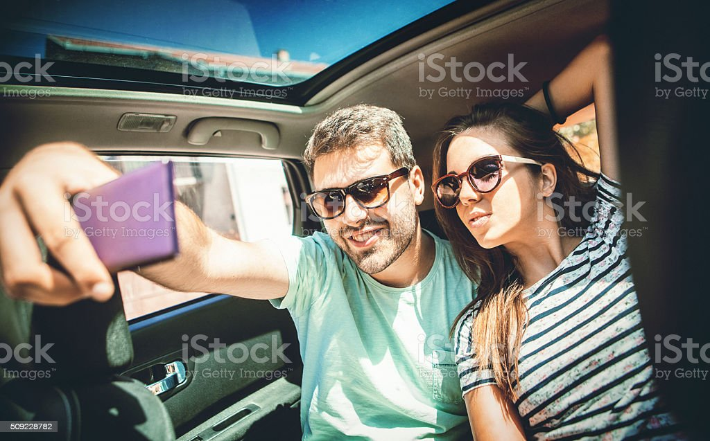 Taking selfie in a car. stock photo