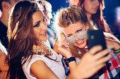 Taking selfie in the club