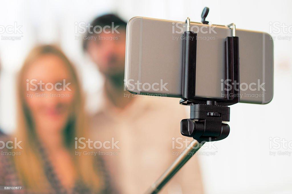 Taking Selfie with Selfie Stick stock photo