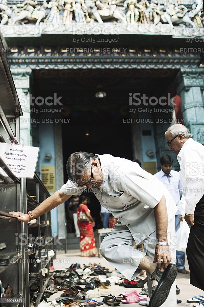 Taking shoes off before prayers. stock photo