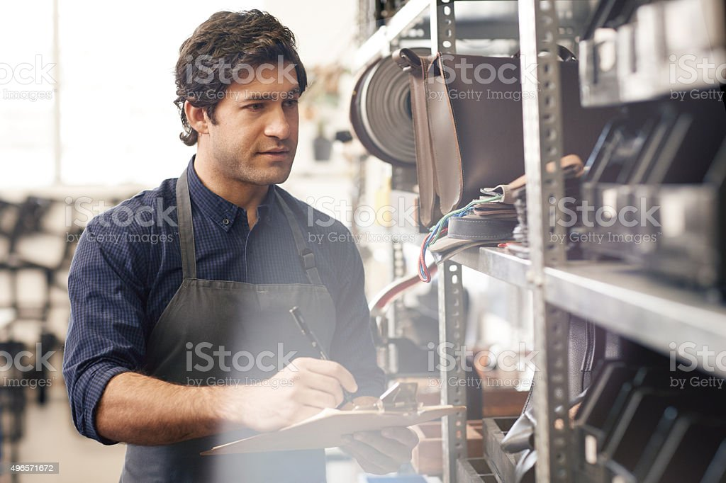Taking stock of his leather products stock photo