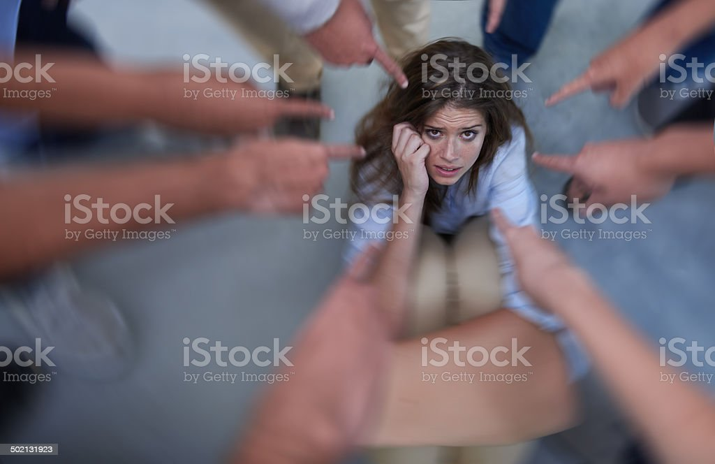 Taking the blame stock photo