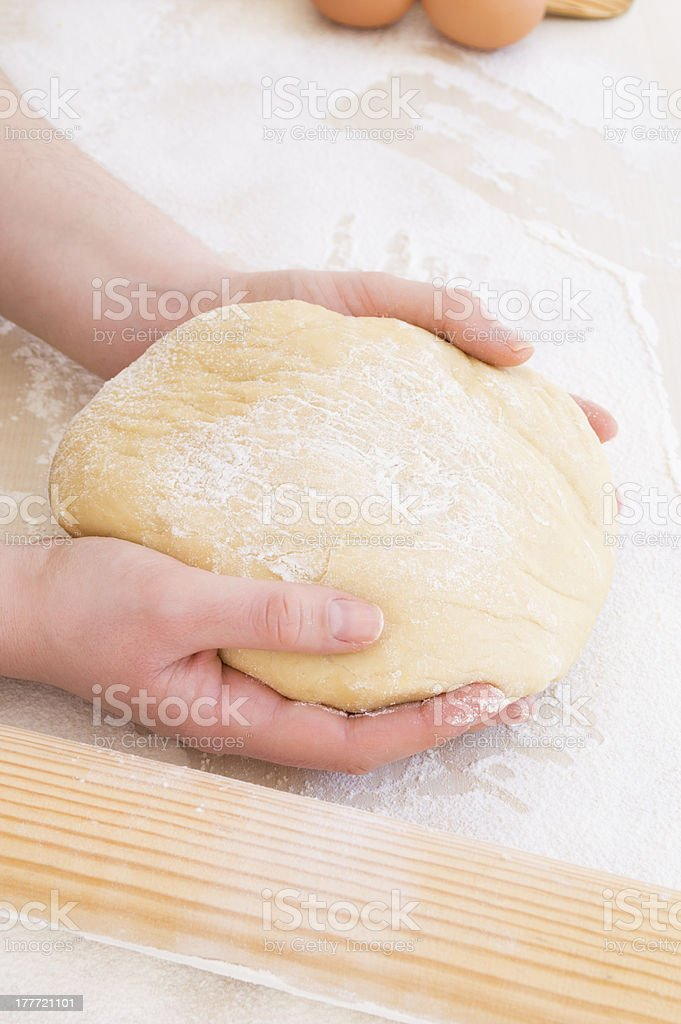taking the dough with both hands royalty-free stock photo