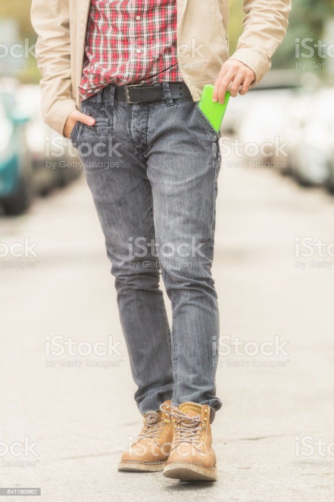 Taking the phone from / to the pocket. stock photo