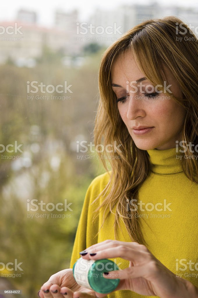 Taking the pill royalty-free stock photo
