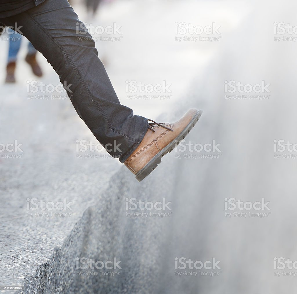 Taking the step into the unknown stock photo