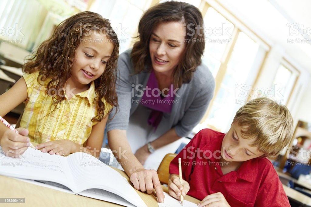 Taking the time to help out her students royalty-free stock photo