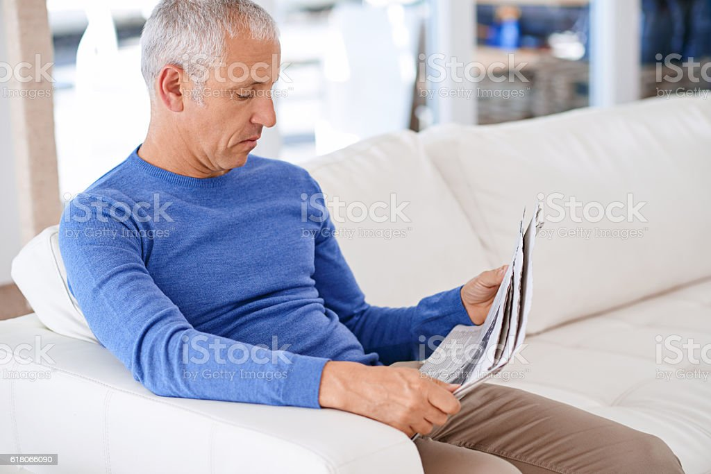 Taking time to catch up on the news stock photo
