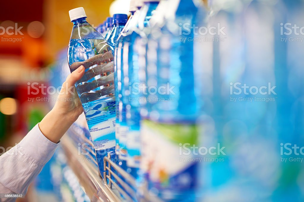 Taking water bottle stock photo